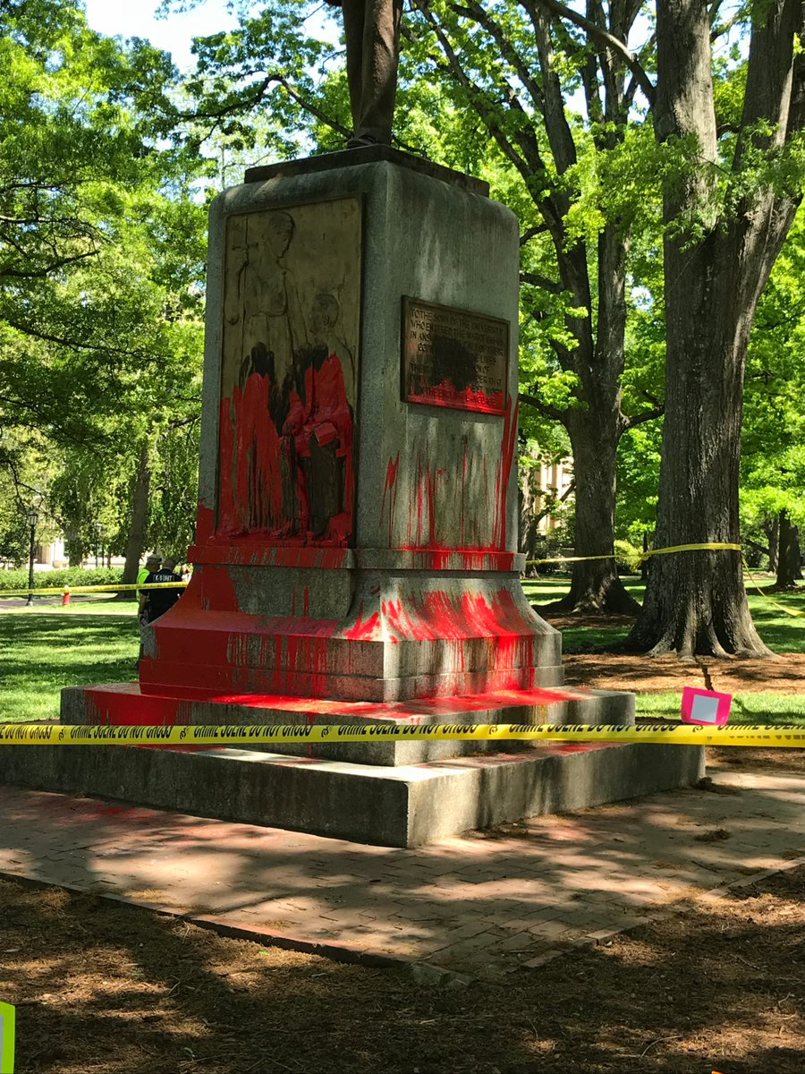 "Statue base of ""Silent Sam"" on campus at UNC-Chapel Hill with ink and blood running down (Image by permission of the Workers Union at UNC-CH)."