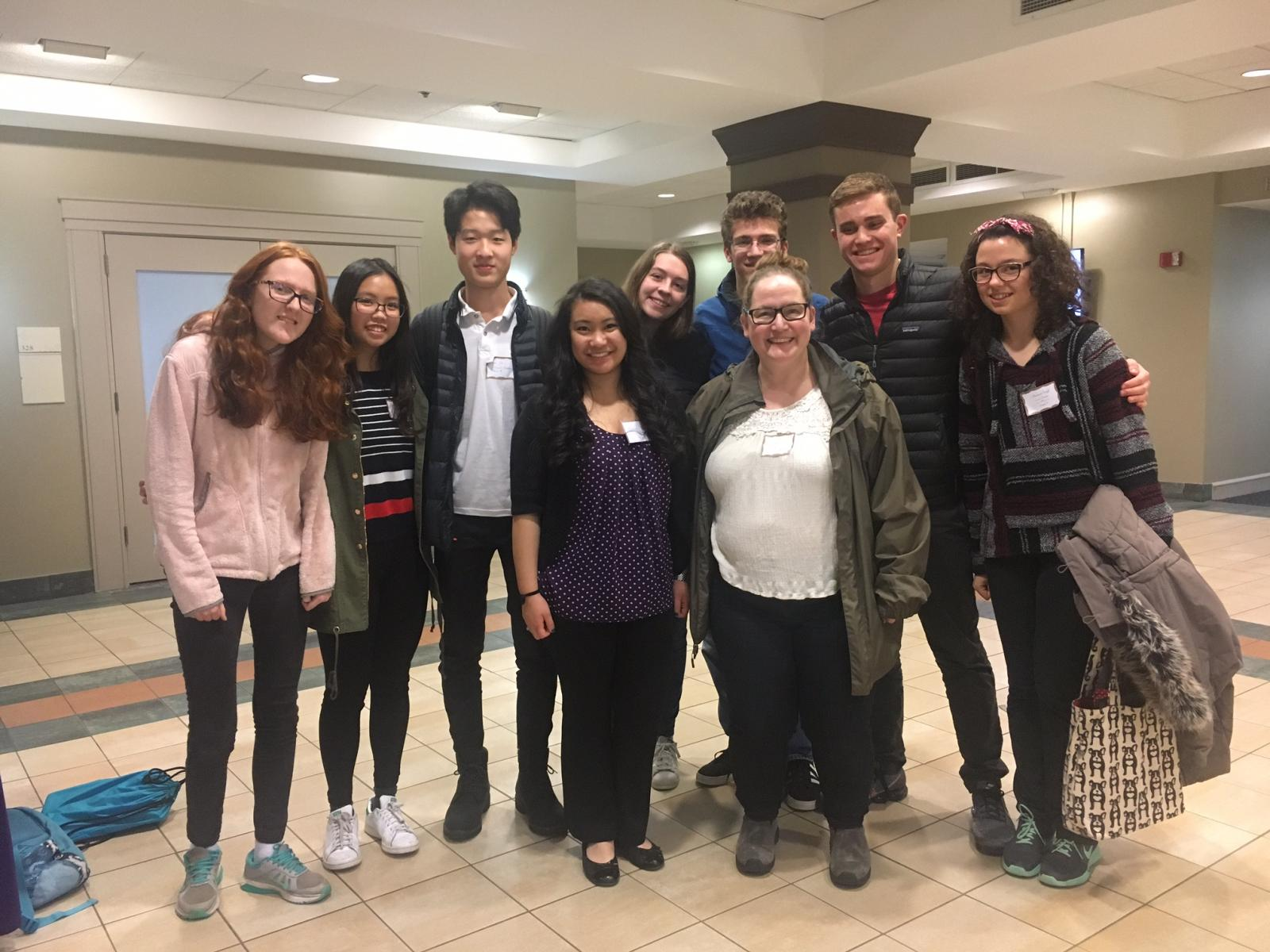 Concord Academy students Katie Painter, Cherie Jiraphanphong, Roger Ge, Lauren Mazza, Liam Yanulis, Ben Zide and Michaela Trieloff with Hackathon organizer Hannah Nguyen and Magistra Liz Penland. Photo credit: Lauren Mazza