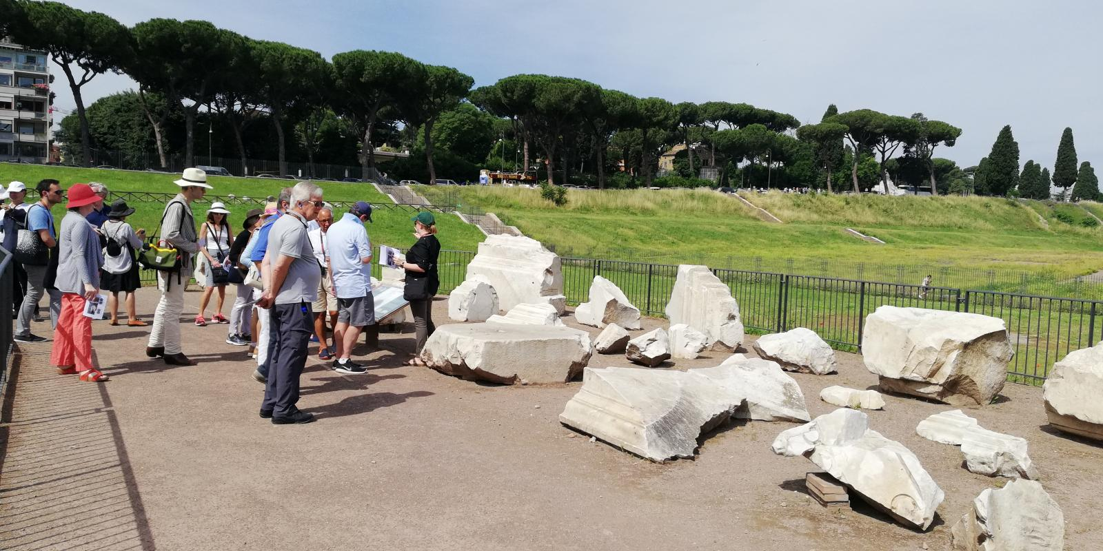 Lauren Donovan Ginsberg and Catherine Bonesho lead tour group at the Circus Maximus. Photo Courtesy of the American Academy in Rome.