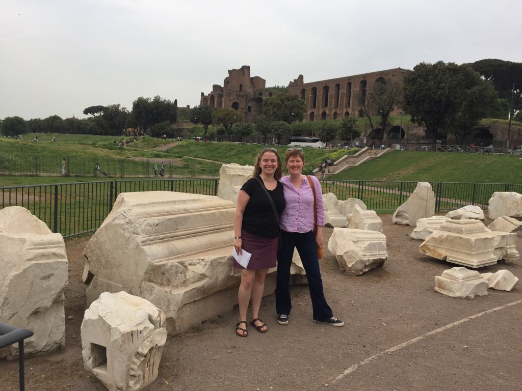 The remnants of the Flavian Triumphal Arch in the Circus Maximus with Lauren Donovan Ginsberg and Catherine Bonesho for size. Photo Courtesy of the American Academy in Rome.