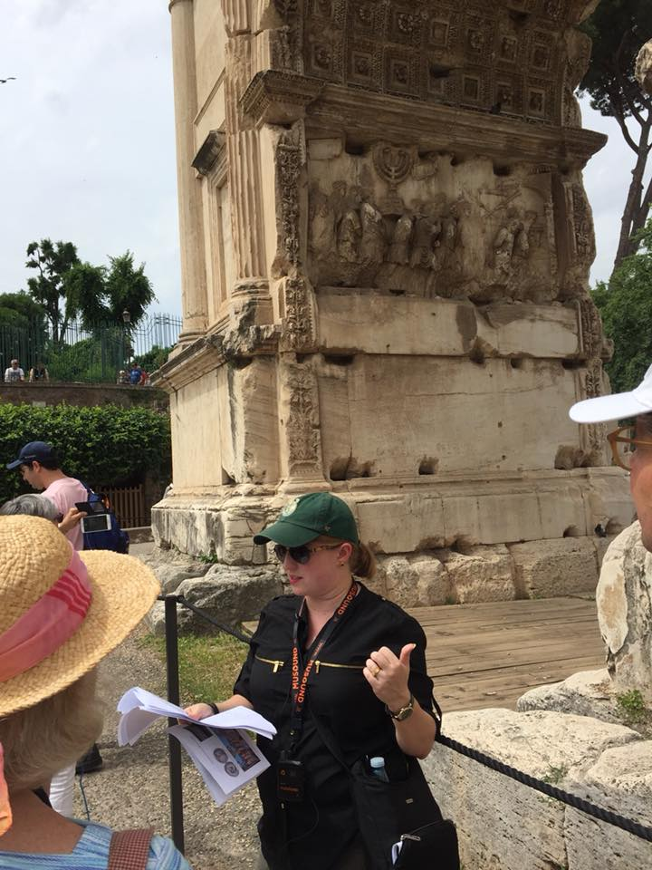 Catherine Bonesho speaking at the Arch of Titus in the Forum. Photo Courtesy of Lauren Donovan Ginsberg.