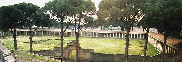 Pompeii gymnasium seen from the top of the stadium wall, 1999. Image via Wikimedia under a CC BY-SA 3.0 License.