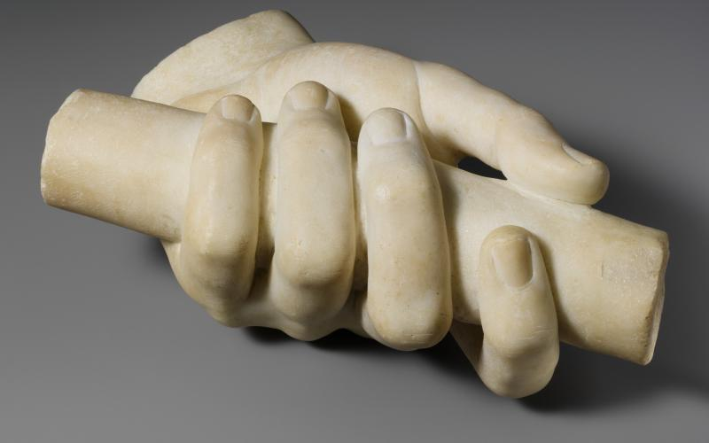 Marble left hand holding a scroll