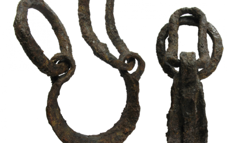 Header Image: Roman slave shackle found at Headbourne Worthy, Hampshire (Image via Wikimedia and taken by PortableAntiquities under a CC-BY-2.0).