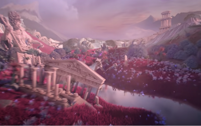 Scene from Lil Nas X's music video for MONTERO. A distorted image of a landscape with red trees, large ancient statues, and ancient buildings.