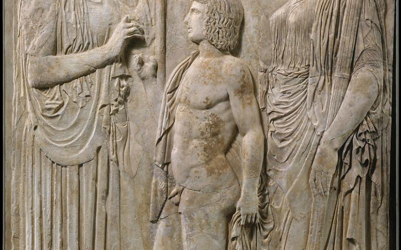 Goddess Demeter and her daughter Persephone give grain to Triptolemos and teach him the art of agriculture. Marble Relief from Eleusis. ca. 430 BCE. Roman copy. ca. 27 BCE – 14 CE. Photo courtesy of the Metropolitan Museum of Art.