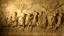 Roman Triumphal arch panel copy from Beth Hatefutsoth, showing spoils of Jerusalem temple. Image via Wikimedia under a CC BY-SA 3.0 License.