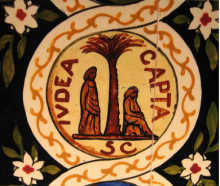 A white circle on a black background with green leaves and white flowers. Around the circle is a yellow vine border, and in the middle there is a palm tree. On the left side of the tree, an abstract figure in drapery stands, and on the right side, a simil