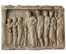 Asclepius, his sons, daughters, and Hygeia in the background with a family of worshippers. Votive Relief from the 4th cent. BCE. National Archaeological Museum of Athens.