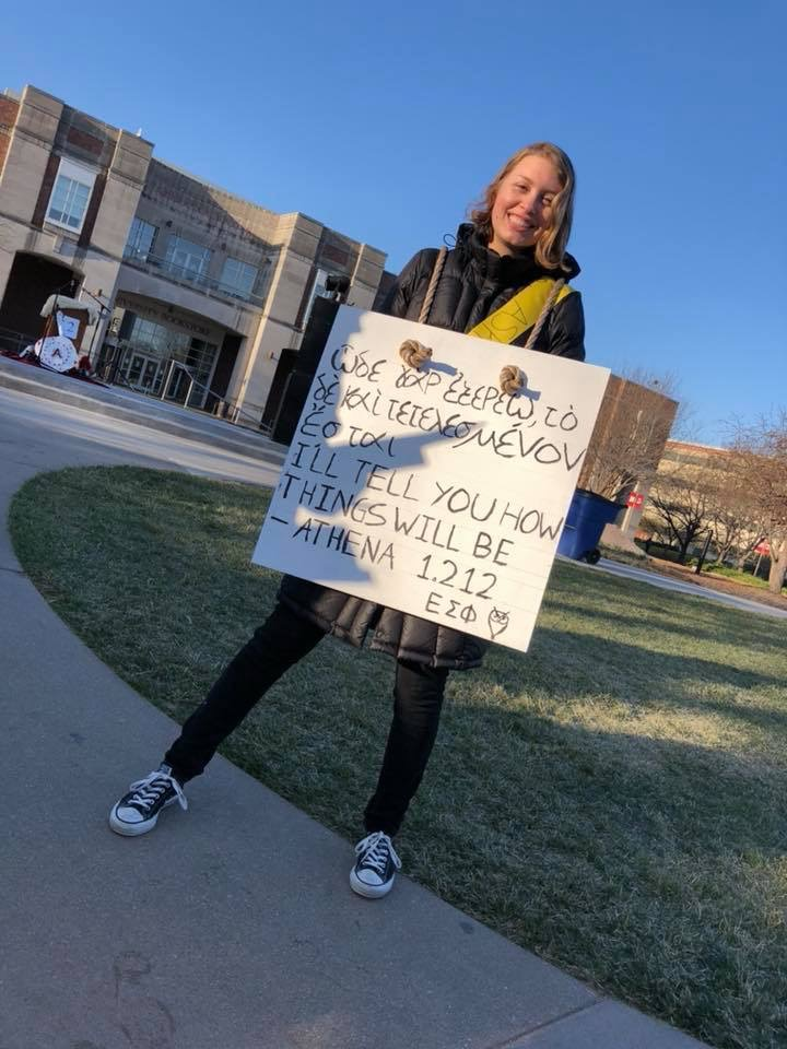 UNL Classics major Paige McCoy drums up support. Photo by Ellie Churchill and used by permission.