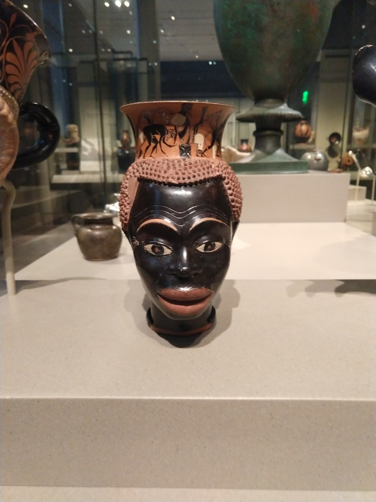 Figure 2. Athenian plastic mug in the form of a black man's head and face, ca. 510 BCE. Museum of Fine arts, Boston. Photo by Najee Olya who discusses his research on Greek painted vases representing Africans in the Peopling the Past blog.